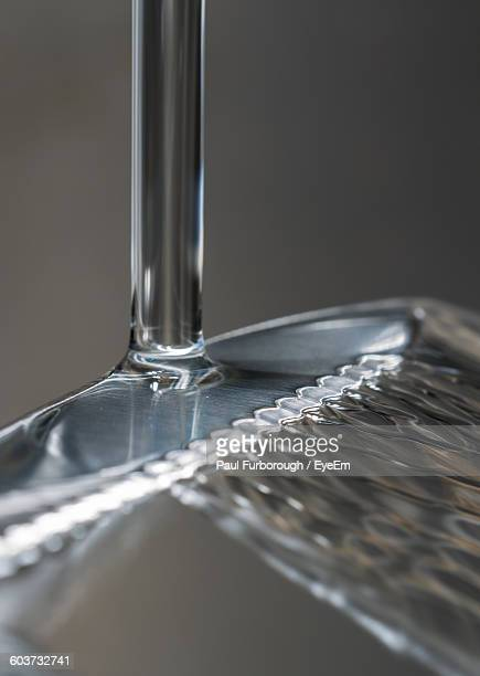 Close-Up Of Water Splashing On Table Knife