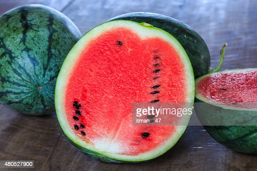 Closeup of Watermelon (Whole and Slice) on Wooden Table. : Stockfoto