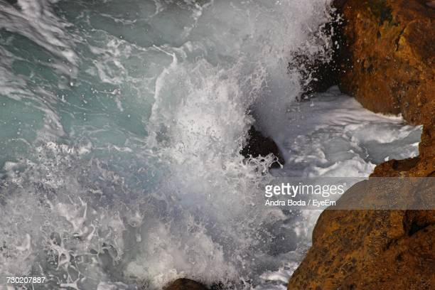 Close-Up Of Waves On Rocks