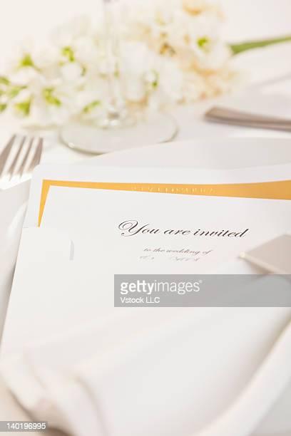 Close-up of wedding invitation on plate