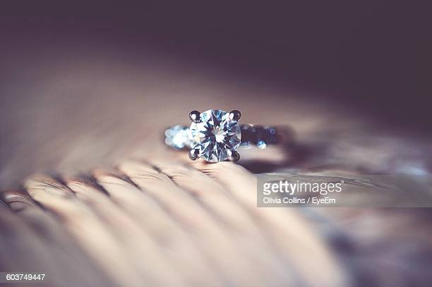 Close-Up Of Wedding Ring On Table