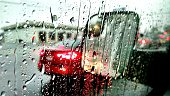 Close-Up Of Wet Car Window During Rainy Season