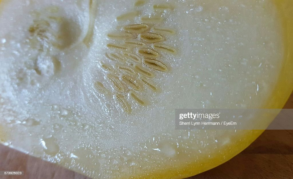 Close-Up Of Wet Pattypan Squash On Table