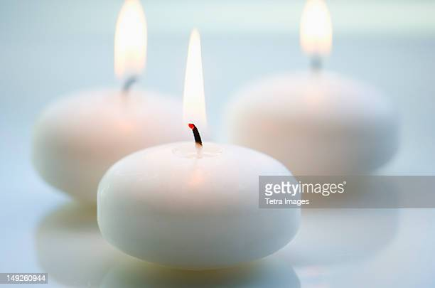 Close-up of white candles