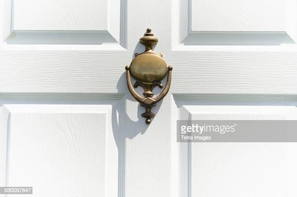 NAPIER Door Knocker Gold and Enamel Dangle Hoop Earrings in |White Door Knocker