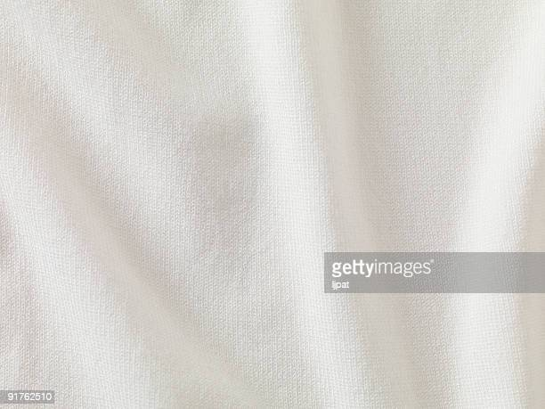 A close-up of white fabric forming a background