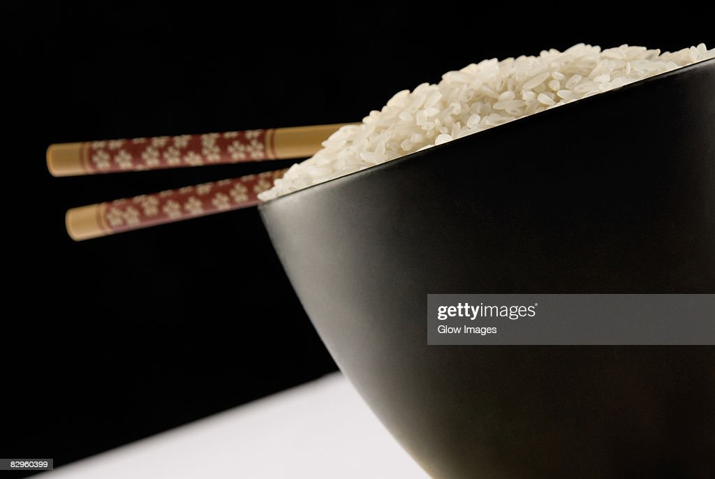 Close-up of white rice and chopsticks in a bowl : Stock Photo
