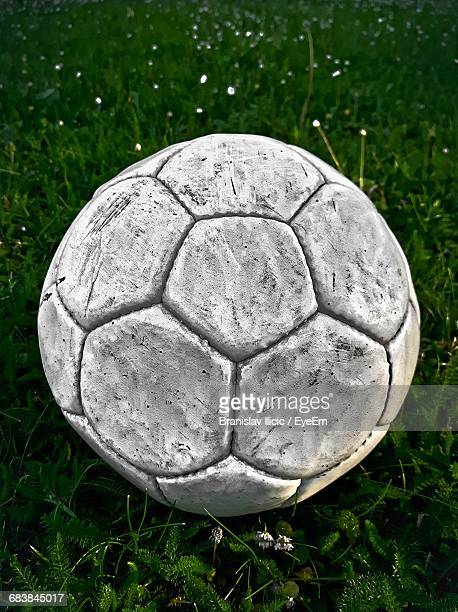 Close-Up Of White Soccer Ball On Grassy Field