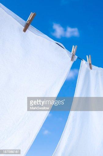 Closeup of whites on clothesline under blue sky