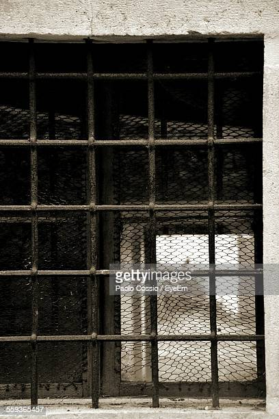Close-Up Of Window Enclosed With Iron Bars