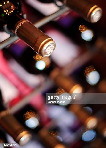 Close-up of wine bottles in cellar