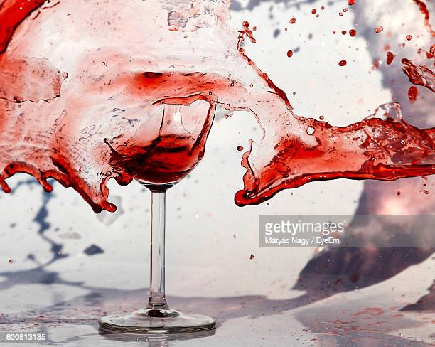 Close-Up Of Wine Spilling From Broken Glass