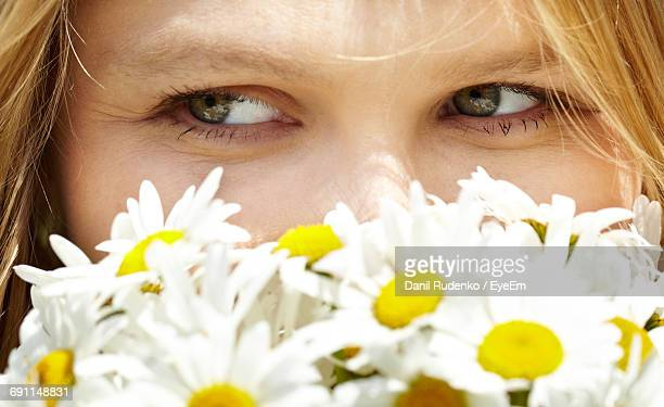 Close-Up Of Woman By White Daisies