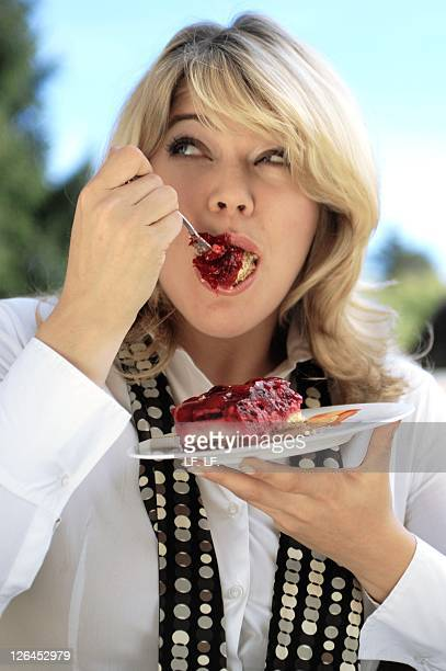 Close-up of woman eating cake