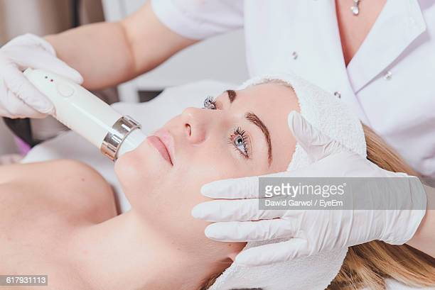 Close-Up Of Woman Getting Facial Beauty Treatment