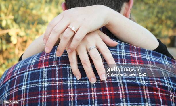 Close-Up Of Woman Hands On Shoulders