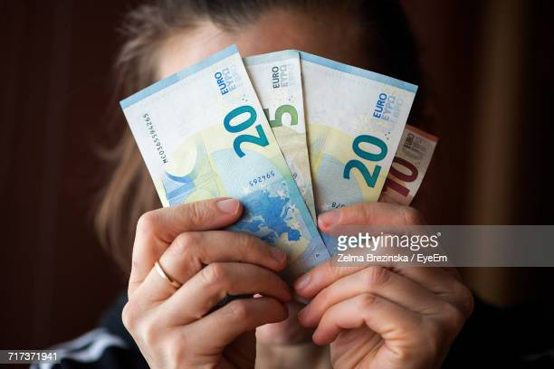 Close-Up Of Woman Holding European Union Currency