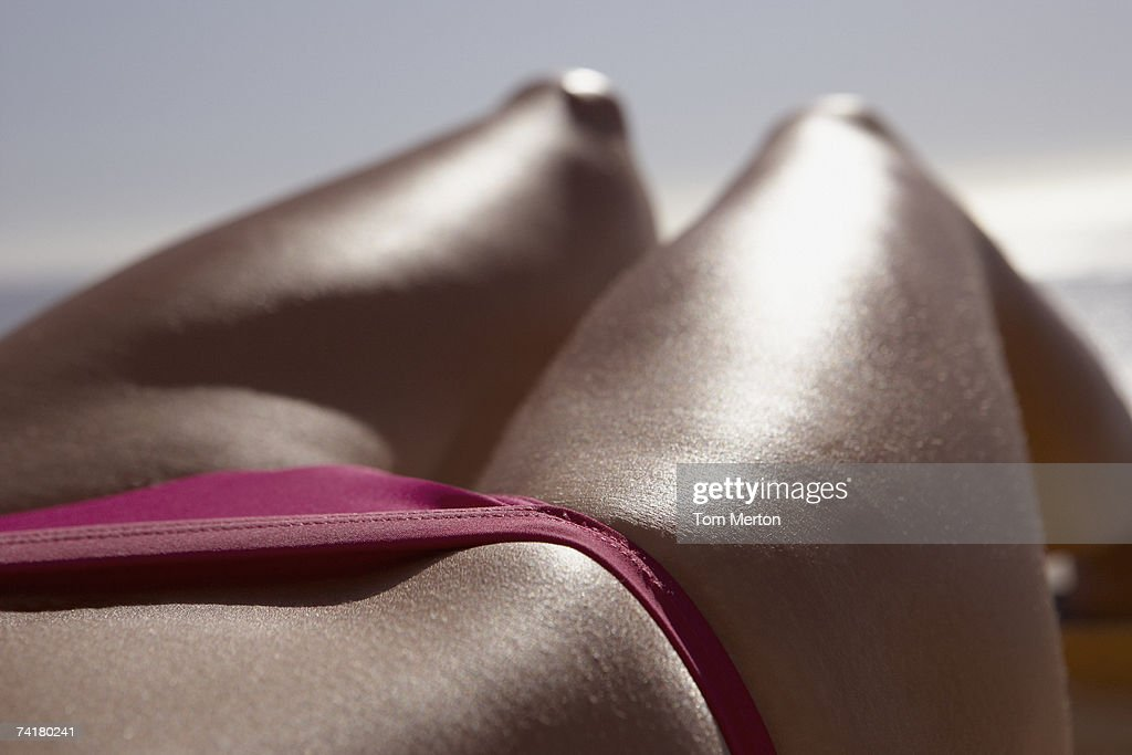 Close-up of woman in bikini waist down : Stock Photo
