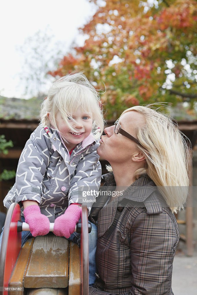 Close-up of woman kissing her daughter (2-3) : Stock Photo