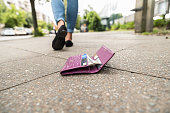 Woman Walking After Losing His Wallet On Street