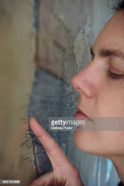 Close-up of woman pointing at a map