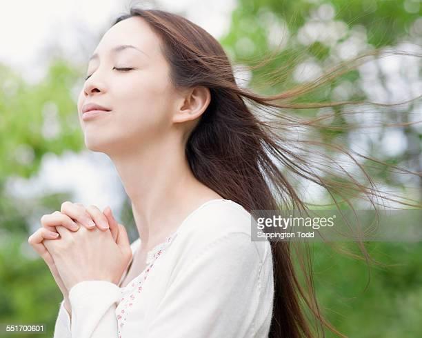 Close-up Of Woman Praying