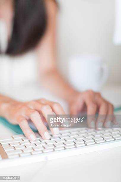 Close-up of woman typing