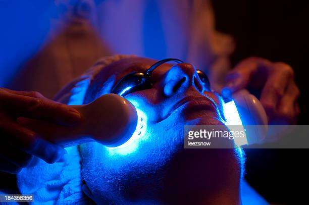 Close-up of woman undergoing light therapy facial treatment
