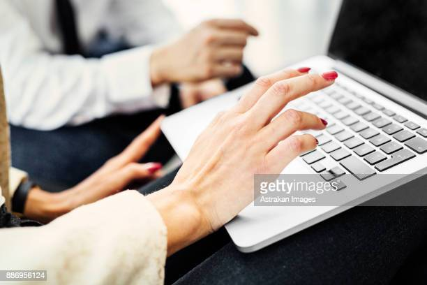 Close-up of woman using laptop