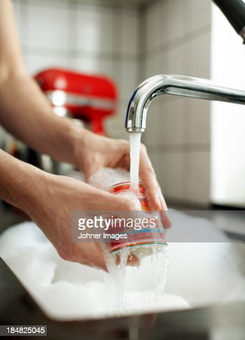 Close-up of woman washing dishes
