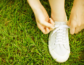 Close-up Of Woman Wearing Shoe