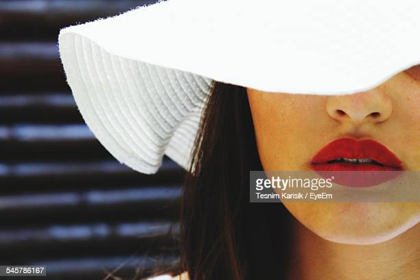 Close-Up Of Woman Wearing Sun Hat