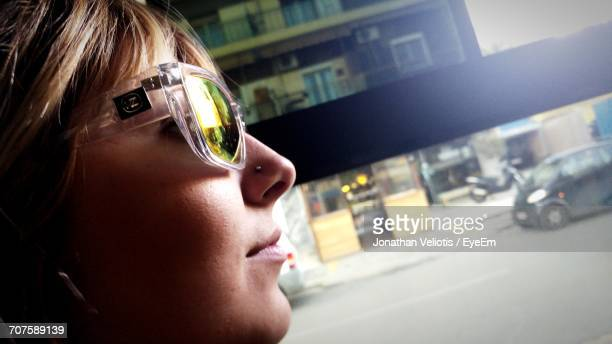 Close-Up Of Woman Wearing Sunglasses In City