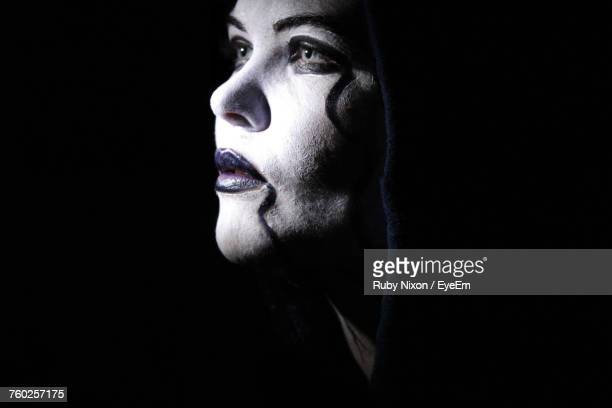 Close-Up Of Woman With Halloween Make-Up Over Black Background