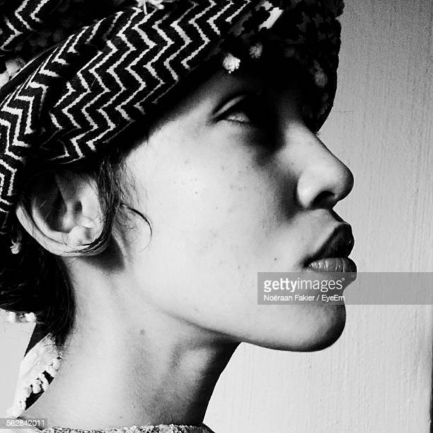Close-Up Of Woman With Headscarf Looking Away Against Wall