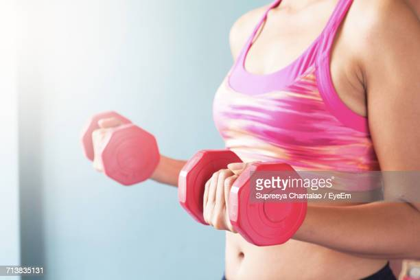 Close-Up Of Woman Working Out