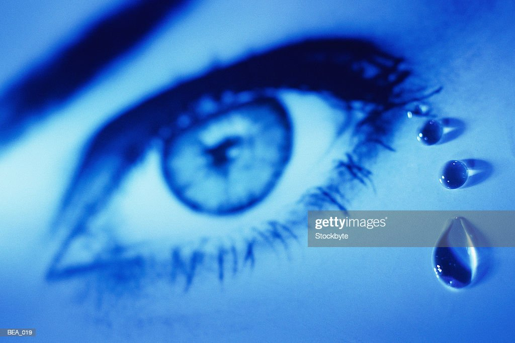 Close-up of woman's eye with teardrops : Stock Photo