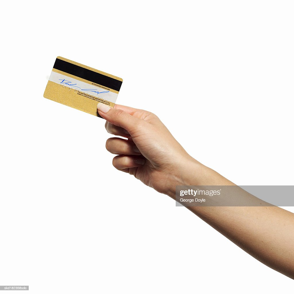 Close-up of woman's hand holding credit card : Stock Photo