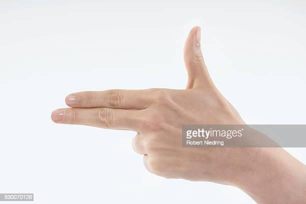Close-up of woman's hand making gun sign, Bavaria, Germany