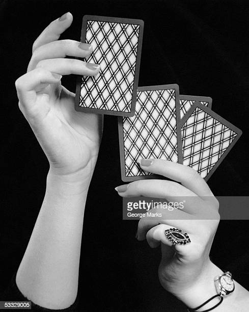 Close-up of woman's hands w/playing cards