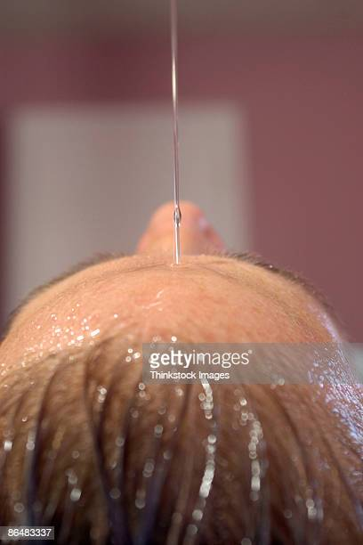 Close-up of woman's head during hot oil therapy