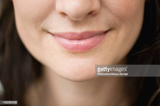 Close-up of woman's smiling lips