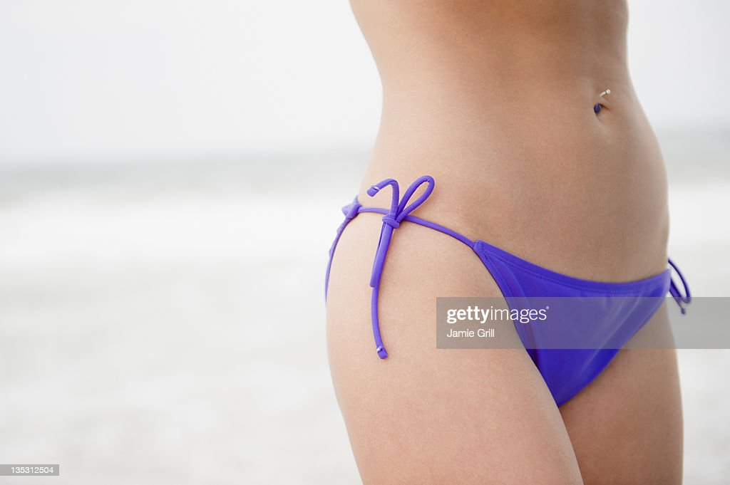 Closeup of woman's stomach in string bikini : Stock Photo