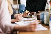 Close-up of women having a breakfast business meet