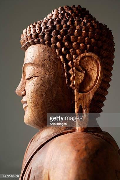 Closeup of wooden Buddha.