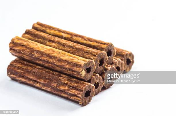Close-Up Of Wooden Dowels Over White Background