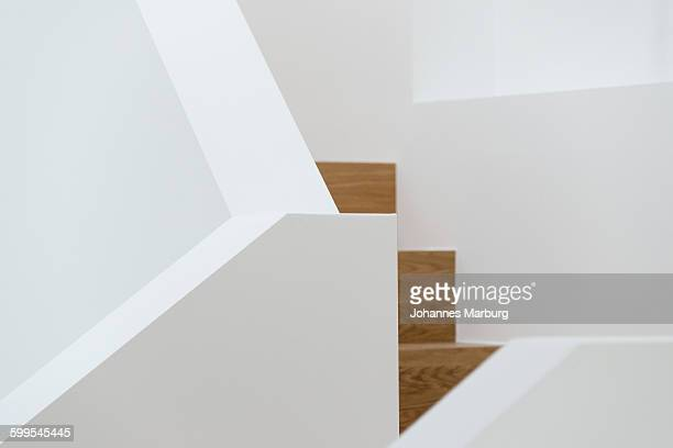 Close-up of wooden steps and white railing