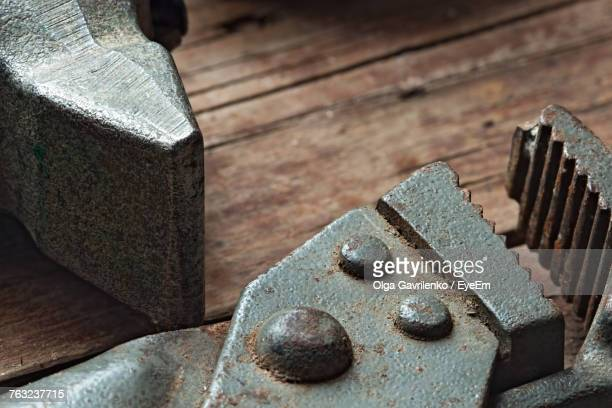 Close-Up Of Wrench On Wooden Table