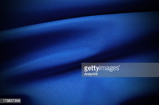 A close-up of wrinkled blue satin