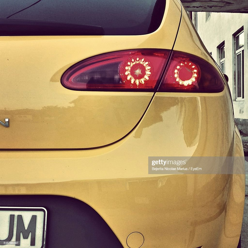 Close-Up Of Yellow Car On Street